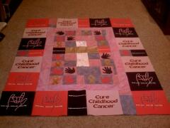 Awesome quilt designed by Betsy Farkas, Feb. 2009 - Betsy used Awareness Ribbon & Baby Handprint appliques to make this awesome quilt