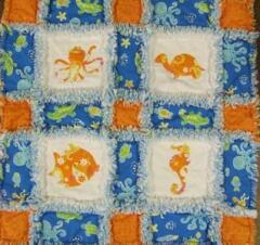Sea Creature Rag Quilt designed by Carolyn Burgess, Sept. 2008  - she used the Sea Creature appliques to make this unique baby quilt for her new nephew