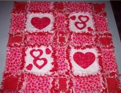Valentine's Day rage quilt - Designed and sewn  by Heidi Dietz, Jan. 2009---- she used the double nested heart & heart appliques to make this beautiful wall hanging.