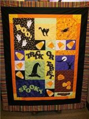 "This adorable ""HALLOWEEN"" quilt designed and sewn by Jo Tracy featured our ghosts, jacko'lanterns and letter appliques, and used the die cutting service with the fabric she sent me; October. 2009"