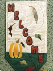 Create a lovely fall banner with letters and autumn leaf appliques