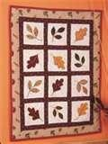 Another lovely fall quilt with various autumn leaf appliques