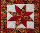 Absolutely gorgeous table mat using the diamond shapes in various autumn colors
