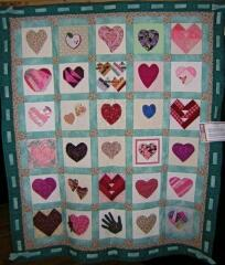 Here's an opportunity to use hearts & hands in a lovely quilt.,  Great idea for childhood cancer quilts, banners, etc.