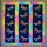 This is a gorgeous quilt using the dragonfly appliques.  Great for little girls of all ages.