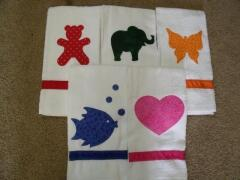 Kids hand towels.  Embellish with appliques and personalize with their names with embroidery or fabric markers.   Great idea for guest towels, holiday/seasonal towels as well. These were sewn by Carol Murphy 2009