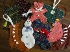 These cut ornaments were decorated by Susan Spaeth, September, 2009.  Sue used her creative scrapbooking techniques to embellish the ornaments.