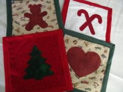 These are samples of Christmas potholders/hotpads designed by Carol Murphy, with adorable Christmas appliques