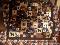 This beautiful puppy quilt was created by Brenda Chisholm 2009 - for her best friend who had recently lost her black lab.