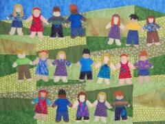 Quilt designed & sewn by Elizabeth Olney, May, 2010. Each of the children in kindergarten class created their own little person.  Some of them look like the child and others are pure fantasy.
