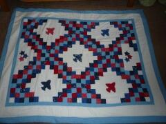 This adorable 'airplane' quilt was designed and sewn by Jana Honey, July, 2010.