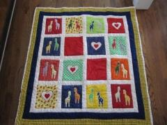 This adorable quilt with giraffes & hearts was made by Jimi Moore, April 2011 for her new grandson.  I am sure he will cherish it forever.