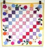 Anna Whorl has been busy .Here is another completed wall quilt.  I used the flower, stem, and leaf die cuts I ordered from you as well as a few yoyo's and button centers. May 2012