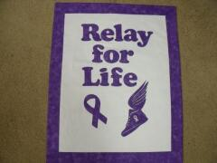 2014, March, Carol is busy, busy, busy.  Here is a Relay for Life wall hanging. Done as a fundraiser for Relay for Life.  She purchased the winged tennis shoes & letters from the website.