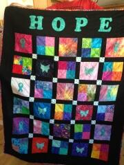 "2016, Jan. - Linda also made this vibrant ""HOPE"" quilt using ribbon & butterfly appliques for Ovarian Cancer"